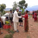 Mr. Bharat distributing coffee plants to the villagers